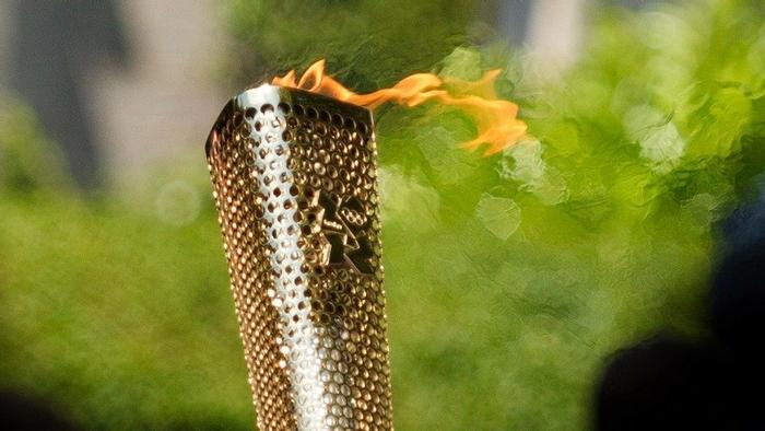 Fackel mit olympischen Feuer