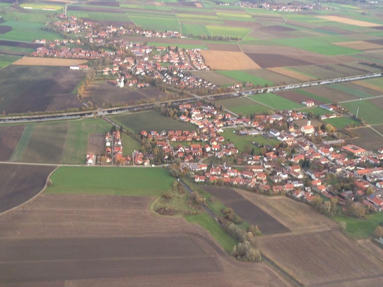 Luftbild eines wachsenden Ortes
